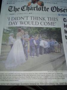 Holy Trinity couples on front page of the Charlotte Observer.